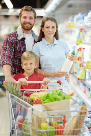 Happy family in supermarket