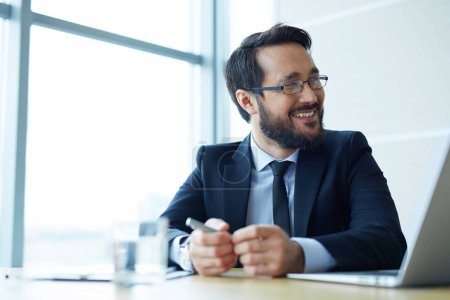 Smiling employee during business talk