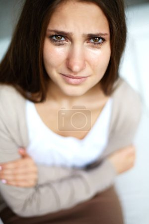 Photo for Crying beautiful girl looking at camera - Royalty Free Image