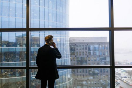 Businessman speaking on mobile phone