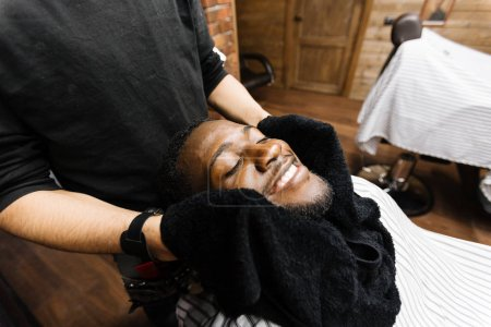 Barber wiping his client face