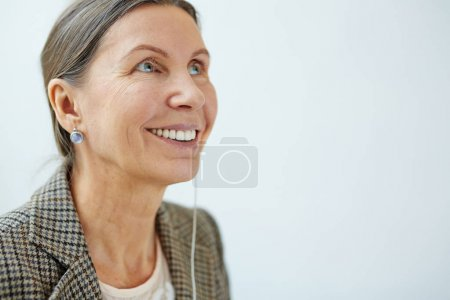 Smiling woman with earphone