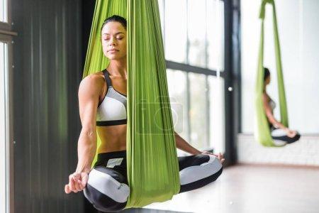 Woman practicing aerial yoga