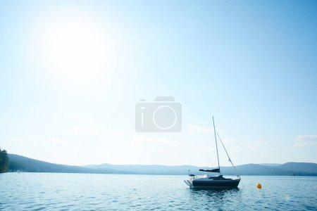 Photo for Empty yacht floating on water among mountains - Royalty Free Image