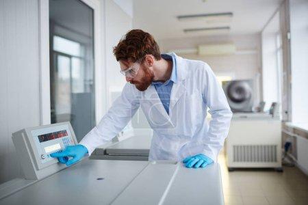Clinician experimenting centrifuge