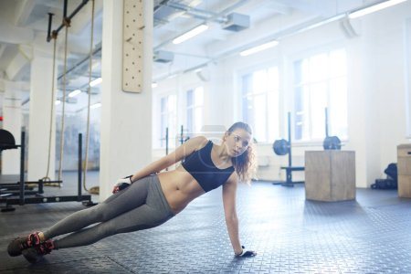 sporty woman practicing plank