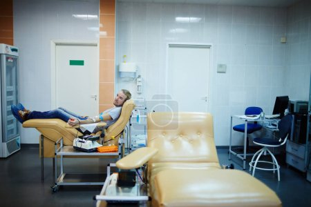 volunteer sitting in clinic