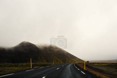 Country road dividing mountains