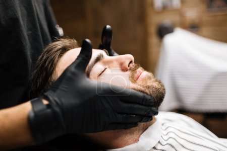 Man enjoying facial massage