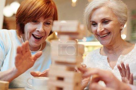 Senior females looking at construction