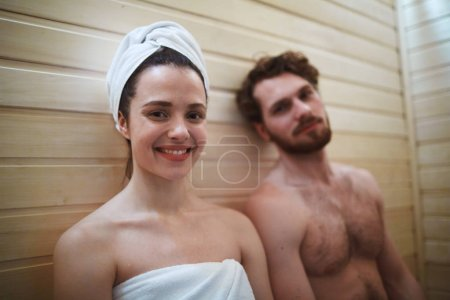 Relaxed couple in sauna