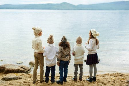 kids standing by water