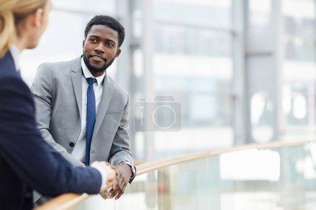 businessmen talking at meeting