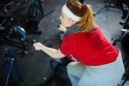 Woman working out on bicycle