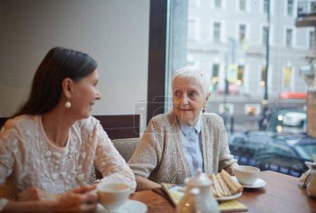 female buddies talking in cafe