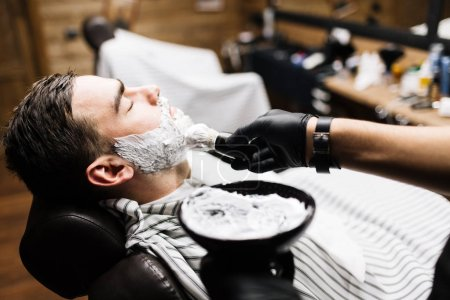 Barber applying shaving foam