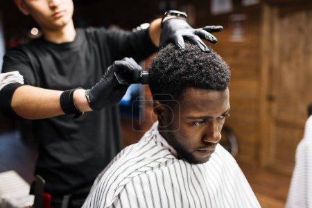 African-american man visiting barbershop