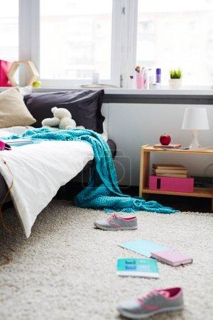 messy bedroom of teenage girl