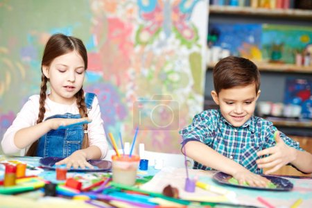 Children making palm prints