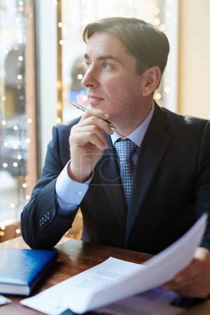 Confident businessman in cafe