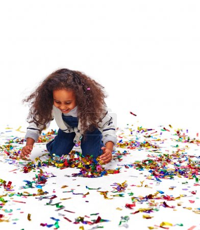 African Little Girl Playing with Confetti