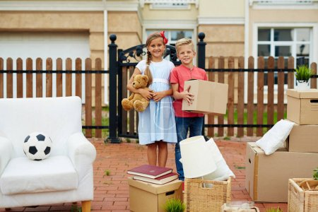 Kids Helping to Move Cardboard Boxes