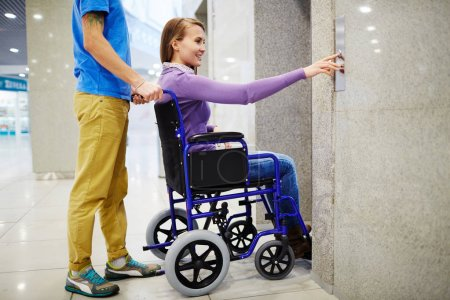 Assistant and handicapped woman