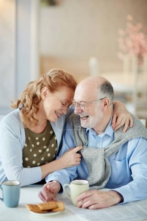 aged couple in love smiling