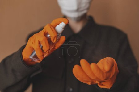 Photo for Close-up of hands applying hand sanitizer against coronavirus. Antiseptic spray to prevent spread of germs, bacteria, coronavirus and virus COVID-19. Antiseptic and sanitizer. - Royalty Free Image