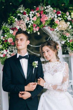 young happy couple of newlyweds on wedding ceremony