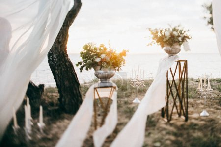 beautiful wedding day decoration by the lake outdoors