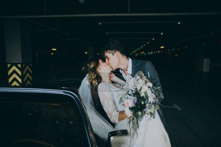 beautiful couple of newlyweds kissing