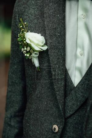 Elegant groom in wedding costume with buttonhole.