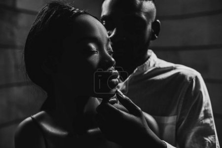 close up portrait of handsome man embracing beautiful woman, monochrome