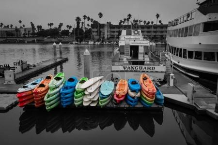 The colorful kayaks were distinguishable in this monochroic scene. This fine art photograph is perfect for wall decoration.