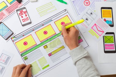 Photo for Web designer draws sketches for applications on the desktop. Development user interface. UX / UI Design Concept. - Royalty Free Image