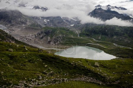 Photo for Majestic landscape with lake, mountains and clouds in Alps - Royalty Free Image
