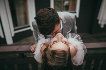 overhead view of beautiful happy couple posing for wedding shoot