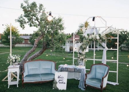 Photo for Beautiful decorative wedding arch with flowers and light bulbs at outdoor wedding - Royalty Free Image