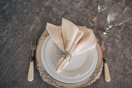 Photo for Top view of elegant served table with plates, glasses, napkin and cutlery at wedding reception - Royalty Free Image