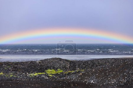 Rainbow over the atlantic ocean in iceland