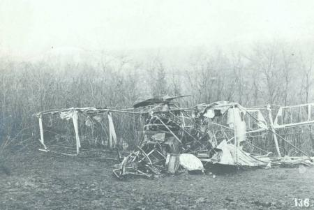 View of wreck of biplane after crashing