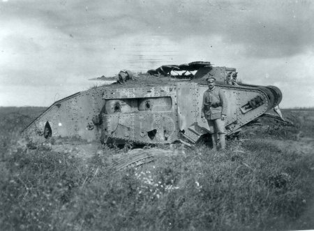 View of soldier and knocked out british Mark IV tank, female version