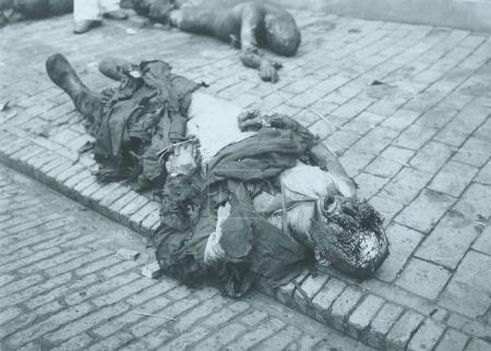 Corpse of dead civilian laying down sideway