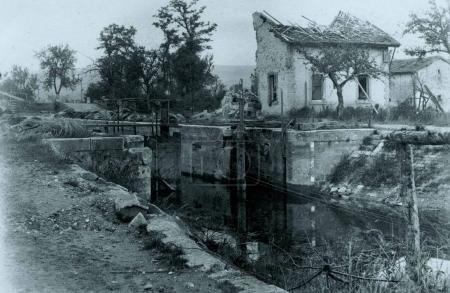 View of damaged house at nearby canal