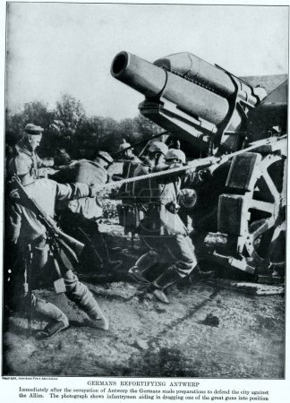 heavy field howitzer towing into position by german troops, defending of Antwerp