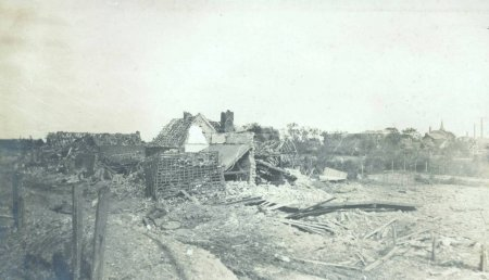 View of heavy damaged buildings in village