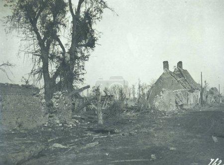 View of heavy damaged small farmhouse