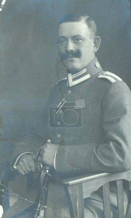 german sergeant posing at camera in studio