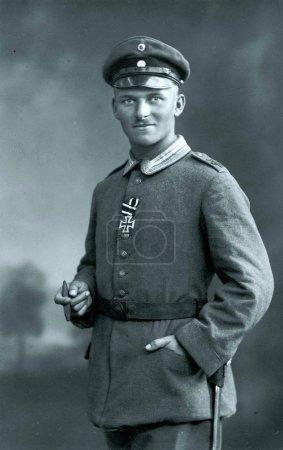 german Sergeant with Iron Cross II posing for photographer in studio